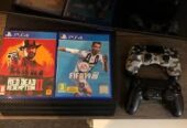Ps4 pro with 2 controllers and 8 games